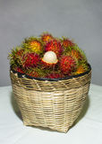 A basket of rambutans. A basket of sweet rambutans Royalty Free Stock Photos