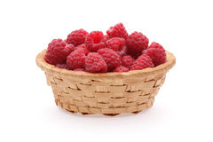 Basket of raspberries. Basket of ripe raspberries isolated on white background Stock Photography