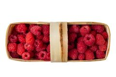 Basket with raspberries isolated on white background.  Stock Photos