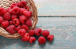 Basket of raspberries on a turquoise wooden table Stock Images