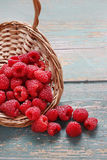 Basket of raspberries on a turquoise wooden table Royalty Free Stock Images