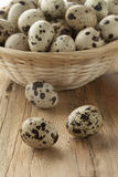Basket with raw Quail eggs Royalty Free Stock Photo