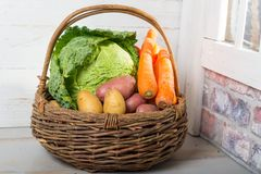 Basket with raw vegetables for cooking a french Pot-au-feu Royalty Free Stock Photo