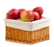Basket with red apples. Isolated on white Royalty Free Stock Images