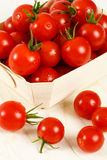 Basket Of Red Cherry Tomatoes Stock Photo
