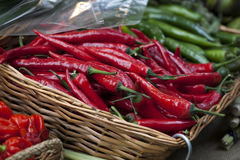 Basket of red chili peppers on Borough market in London Stock Photo