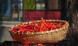 Basket with Red Chili Peppers Stock Photos