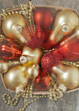 In a basket red and gold Christmas balls and space effect Royalty Free Stock Photos
