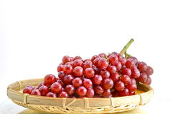 A basket of red grapes Royalty Free Stock Photos