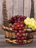Basket of Red and Green Grapes Closeup Stock Image
