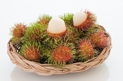 Basket of red hairy rambutan fruits. Stock Photo