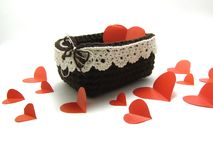 Basket with red hearts. The basket is handmade with red paper hearts on a white background royalty free stock photos