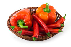 Basket with the red  peppers isolated on white Stock Photo