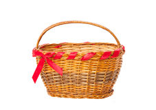 Basket with red ribbon bow. Isolated on white Royalty Free Stock Image