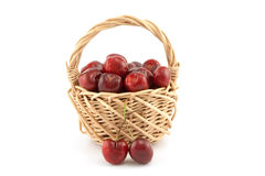 Basket with red ripe cherries Stock Images