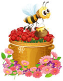 A basket of red roses and a bee with a pot of honey Royalty Free Stock Photo