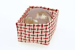 A basket of red and white with world crystal globe Royalty Free Stock Photography