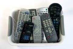 A basket of remotes. A collection of remote controls Stock Photos