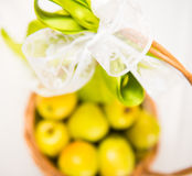 Basket with ribbon filed with apples Stock Photos