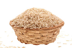 Basket with rice. On a white background Stock Photography