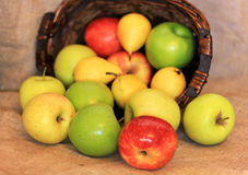A basket of ripe apples and pears Stock Photo
