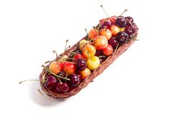 Yellow and red sweet cherry in basket isolate on white. Basket with ripe berries of yellow and red sweet cherries on white background royalty free stock photo