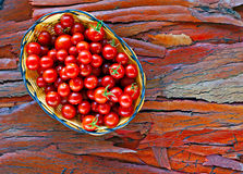 Basket of ripe cherry tomatoes Stock Photos