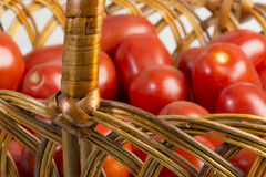 Basket with ripe fresh tomatoes Stock Images
