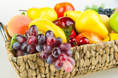 Basket of ripe fruit. Colorful basket of ripe fruit with with studio background Stock Photos