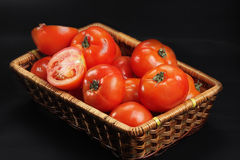 Basket with ripe red tomatoes Stock Photos