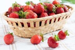 Basket of ripe strawberries on napkin stock photography