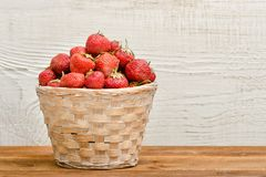Basket of ripe strawberries on a white wooden background. Space. For text Royalty Free Stock Photography