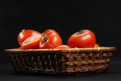 Basket with ripe tomatoes Royalty Free Stock Images