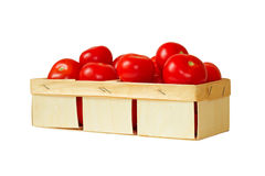 Basket of ripe tomatoes on a white background. Royalty Free Stock Photography