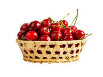 Basket with ripe wet cherry isolated Stock Images