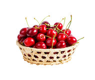 Basket with ripe wet cherry isolated Royalty Free Stock Photo