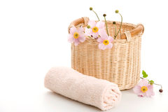 Basket, rolled towel and anemones Royalty Free Stock Photos