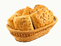 Basket with rolls. Isolated on a white background Royalty Free Stock Photos