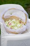 Basket with rose petals. On a wedding ceremony royalty free stock image
