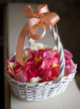 Basket with rose petals Royalty Free Stock Photos