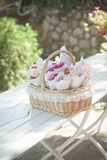 A basket of rose petals for the wedding. Standing on a white table Royalty Free Stock Photos