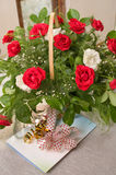 Basket with roses and a card. Royalty Free Stock Photo