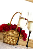 Basket with roses and champagne Royalty Free Stock Image