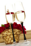 Basket with roses and champagne Stock Photography
