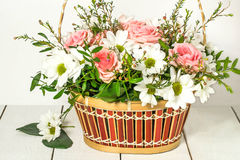 Basket with roses and chrysanthemums Royalty Free Stock Image