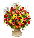 Basket of roses, gerberas and palm leaves stock photos