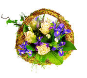Basket of roses, iris dutch xiphium, and veronica Stock Photo