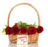 Basket with roses and a note  close-up Royalty Free Stock Images