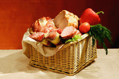 Basket of sausages and meats Stock Image