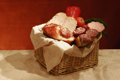 Basket of sausages and meats Royalty Free Stock Photo
